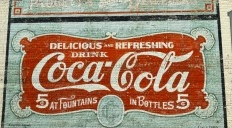 Image of the Coca-Cola mural painted on a building.
