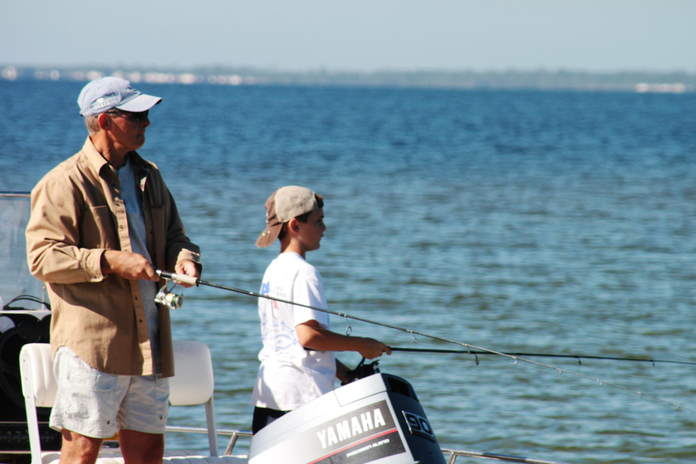Image of father and son fishing.