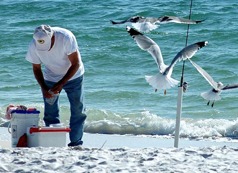 Image of man beach fishing.