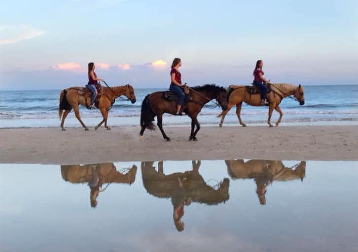 Image of horseback riding on the beach.