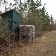 Hunting blinds on the edge of a field.
