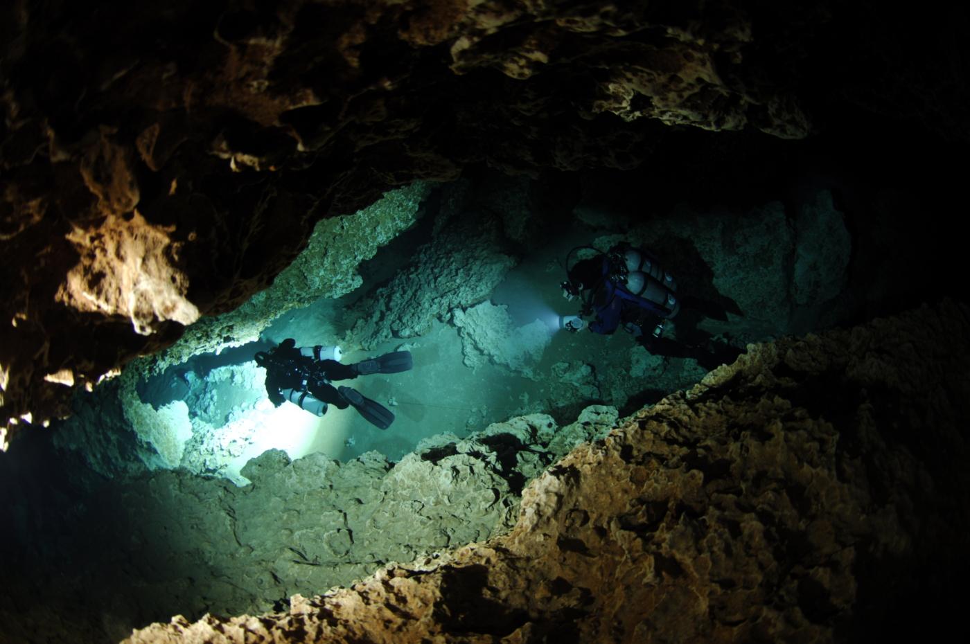Image of scuba divers cave diving.