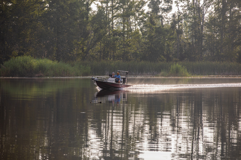 Image of a boat skiff crossing the water.