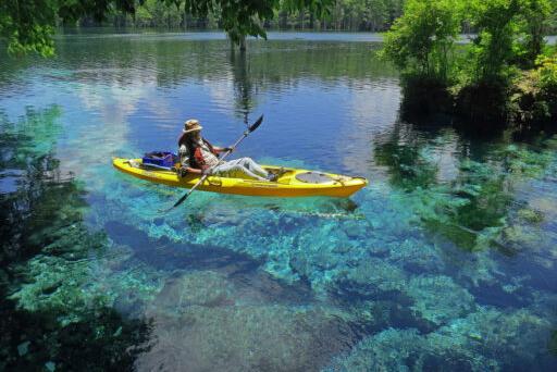 Image of someone kayaking on Merritt's Mill Pond.