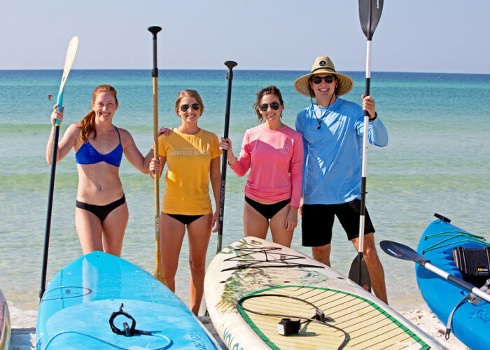 Image of 4 paddlers reading to take on the water in South Walton.