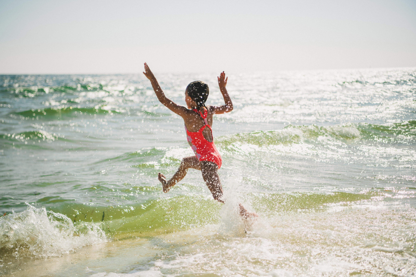 Image of young girl playing in water.