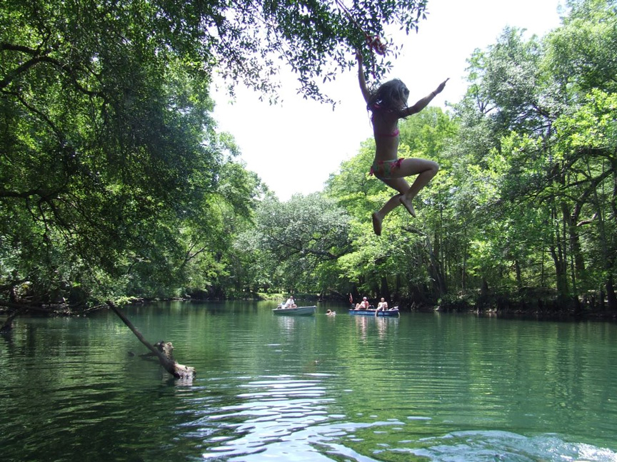 Image of a child jumping into a spring.